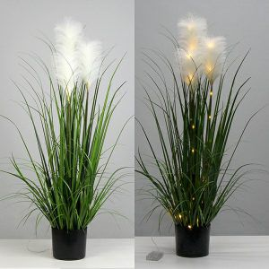 Artificial reed grass in pots with solar lights