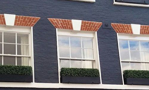 balcony used artificial hedges in planters