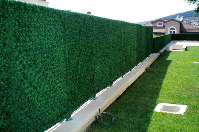 dark green artificial turf applied on fence