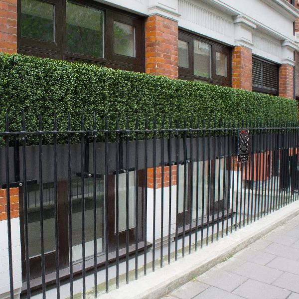 landscape of artificial box hedge planters