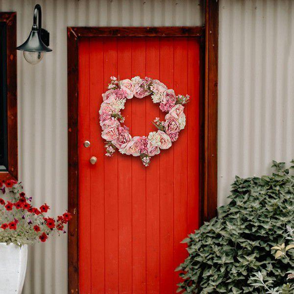 Application of front door wreath