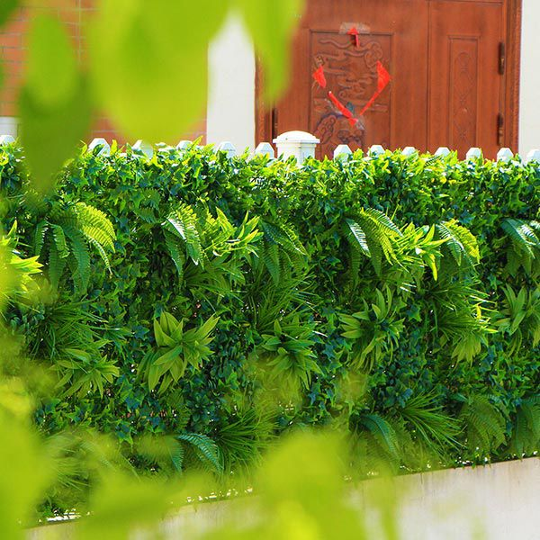 Artificial wall plants on the fence