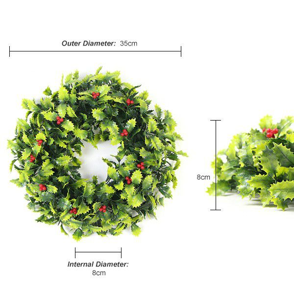 Faux plant wreath of Christmas leaves and red berries