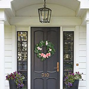door wreaths with flowers and leaves