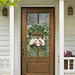front door with faux plants wreath