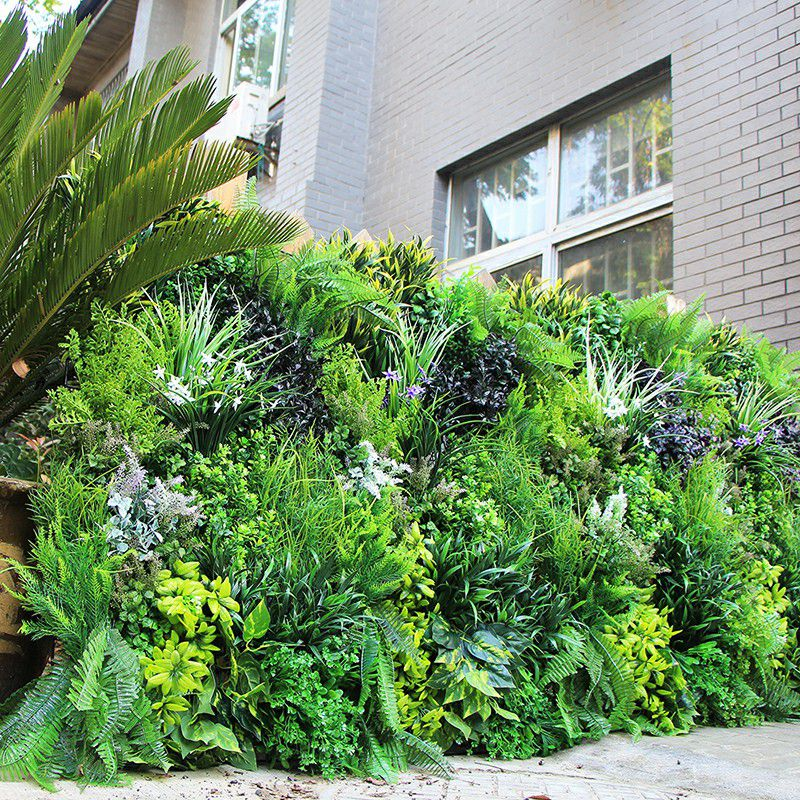 Artificial plants wall with mounted leaves