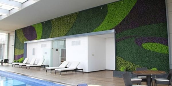 artificial outdoor plants around the pool