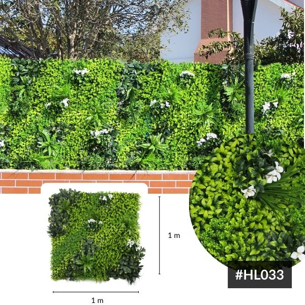 artificial green wall panel with white bougainvillea